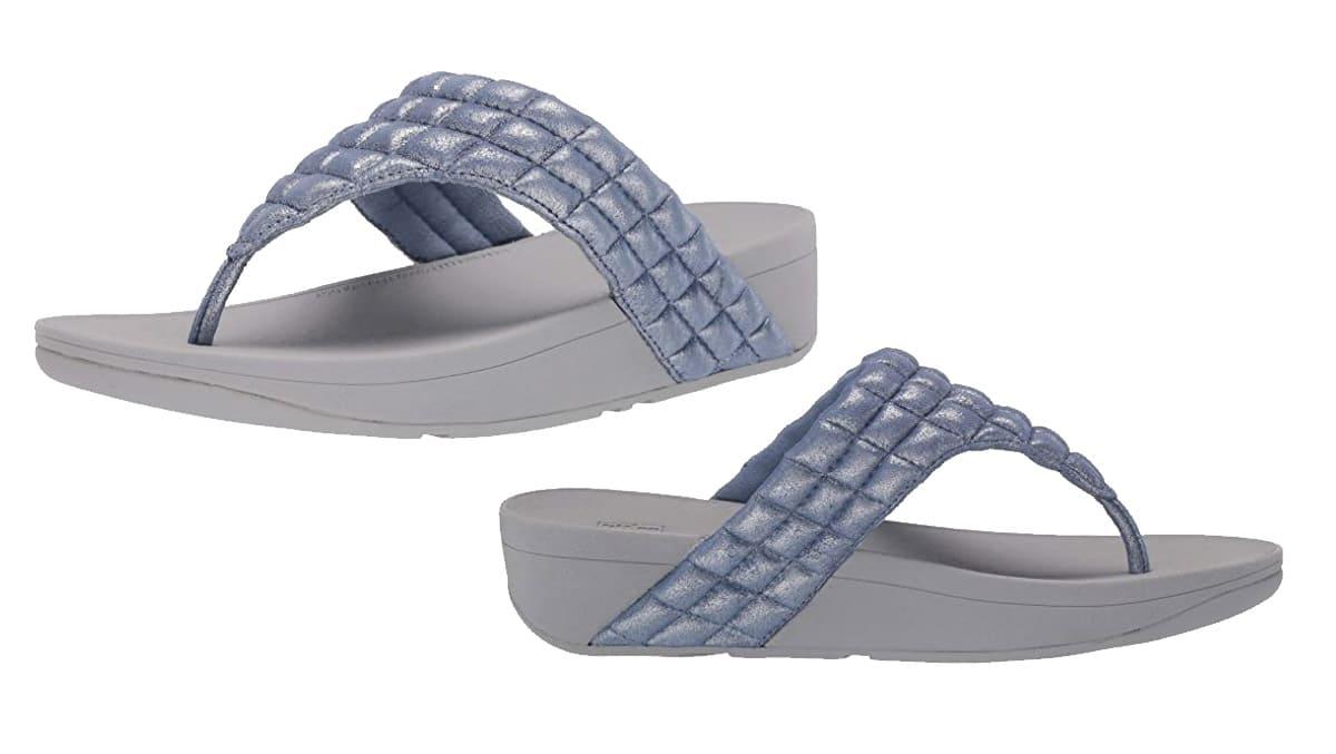 FitFlop Zehensteg-Sandale Lulu padded slide. Farbe: schimmernd blau.